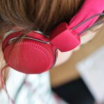 up close shot of person wearing pink headphones