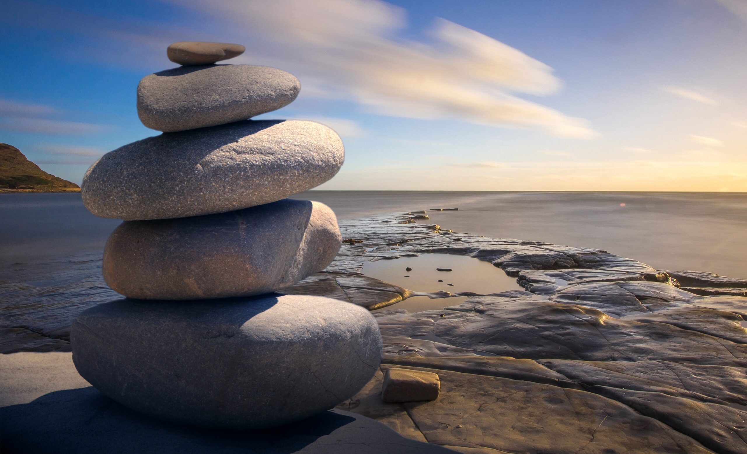 Stack of smooth rocks on a beach