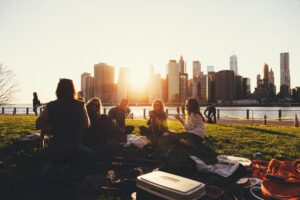 a group of friends on a picnic in a park by the water